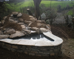 rockery with stream and pond